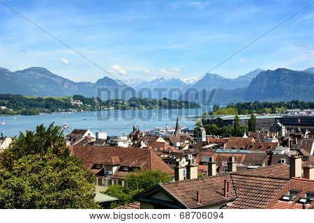 LUCERN, SWITZERLAND - JULY 3, 2014: Overview of Lucern City, the lake and Alps. From this vantage you can see Lake Lucern, City Central including Museum and Train Station, Churches and Boat Docks