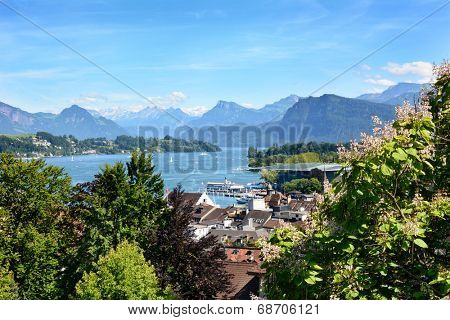 LUCERN, SWITZERLAND - JULY 3, 2014: Overview of Lucern City, the lake and Alps. From the Musegg Wall you get a stunning view of the city and lake, art museum and the alps in the distance.