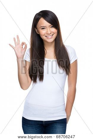 Young asian woman ok sign on white background