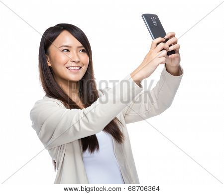 Asia young woman taking selfie with mobile phone isolated