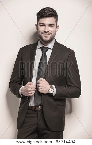 young business man with a cute smirk on his face looking at the camera