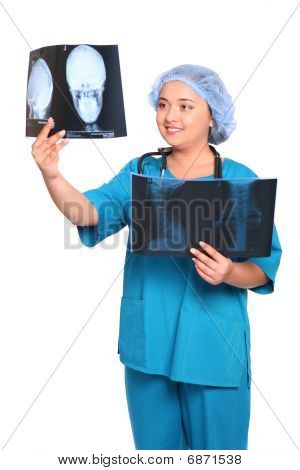 Smiling Asian Doctor Looking At An Xray