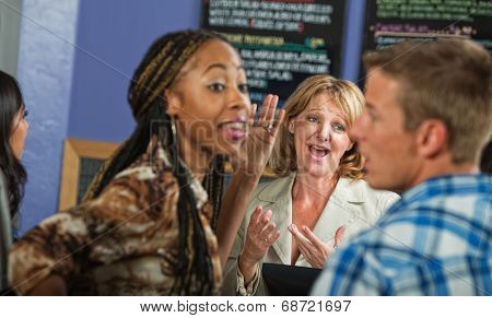 Cafe Owner With Irritated Customers