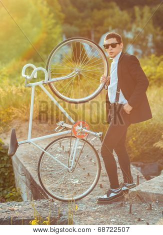 Young Stylish Guy With Bicycle Outdoors
