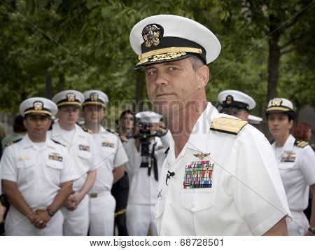 NEW YORK - MAY 23, 2014: A portrait of Rear Admiral Scott A. Stearney standing in front of US Navy officers during the re-enlistment and promotion ceremony at the National September 11 Memorial site.