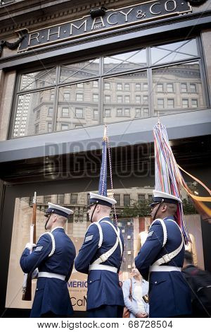 NEW YORK - MAY 23: Three members of the US Coast Guard Silent Drill Team march past the Herald Square Macys window display in Manhattan during Fleet Week NY on May 23, 2014.