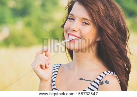 girl playing with chewing gum