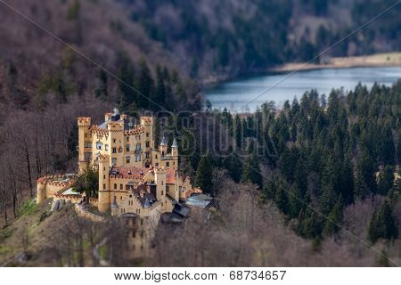 Hohenschwangau Castle (Schloss Hohenschwangau), Alpsee and Schwansee - aerial view from Neuschwanstein Castle with tilt shift toy effect shallow depth of field. Bavaria, Germany