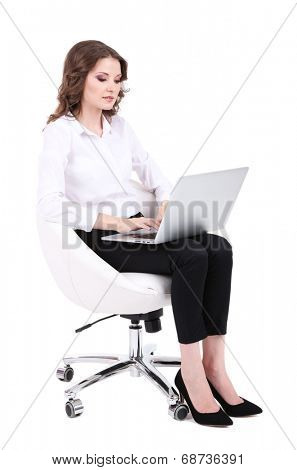 Young business woman sitting on chair with notebook isolated on white