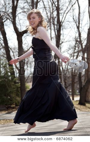 Cute teen girl in black prom dress