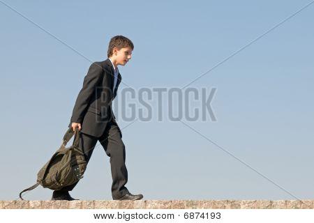 Successful School Student Walks Home