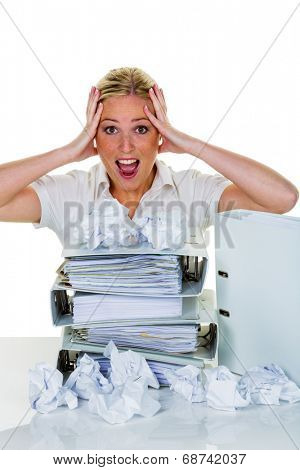 young woman in office is overwhelmed with work. burnout in work or study.