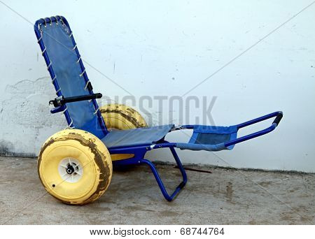 Blue Wheelchair With Wheels With Rubber Tires To Go In The Sea