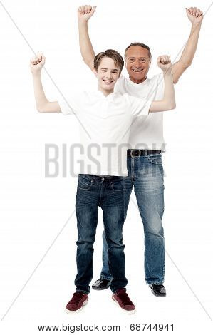 Father And Son Enjoying Their Victory