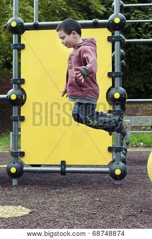 Child Jumping At Playground