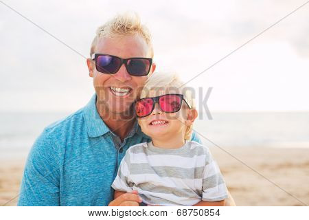 Happy loving father and son at the beach