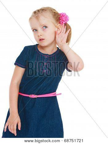 The girl in the blue denim dress something overhears