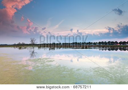 Beautiful Sunset Sky Reflected In Lake