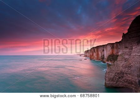 Fire Sunrise Over Cliffs In Atlantic Ocean