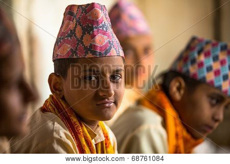 KATHMANDU, NEPAL - DEC 9, 2013: Unknown children during the reading of texts in Sanskrit at Jagadguru School. School established at 2013 to let preserve Hindu culture.