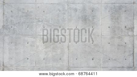 Raw or bare concrete wall, light color, shot with panel seam lines perpendicular to image dimension.
