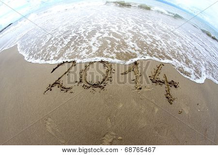 Wave That Erases 2014 Year Written On The Sea Beach 2
