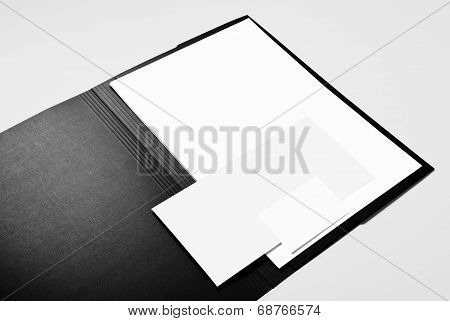 Folder, blank letterhead, envelope and business card