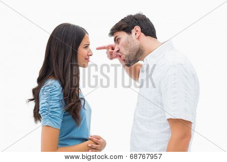 Angry man shouting at upset girlfriend on white background
