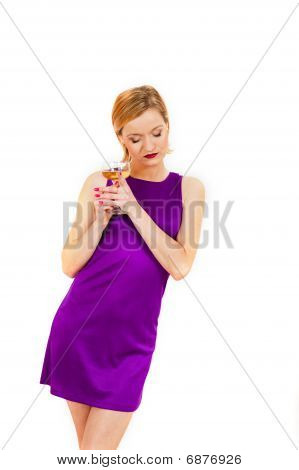 Young elegant woman in a dress with glass of champagne celebrating