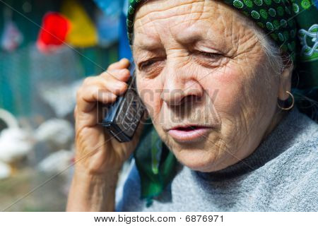 East European Senior Woman And Mobile Phone