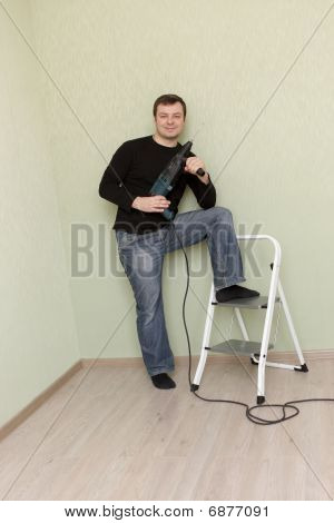 Man Poses With Perforator