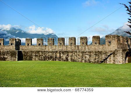 BELLINZONA, SWITZERLAND - JULY 4, 2014: Lawn and Ramparts at Castelgrande, Bellinzona. A UNESCO World Heritage Site, the fortress overlooks the town of Bellinzona providing dramatic vistas.