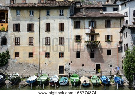 GANDRIA, SWITZERLAND - JULY 5, 2014: Boats on the shore at Gandria on Lake Lugano. Private boats lined up on the shore at the foot of a building on Switzerland's Lake Lugano.