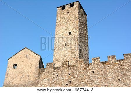 BELLINZONA, SWITZERLAND - JULY 4, 2014: Torre Bianca (White Tower) and ramparts at Castelgrande, Bellinzona. Castelgrande is a UNESCO World Heritage Site since 1983.