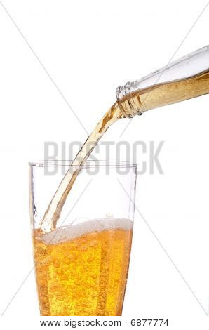 Vertical Image Of Beer Being Poured Into A Pilsner Glass On White