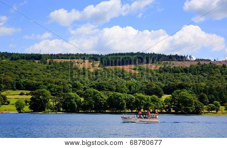 Pleasure boat Coniston water Lake District England uk on a beautiful blue sky summer day