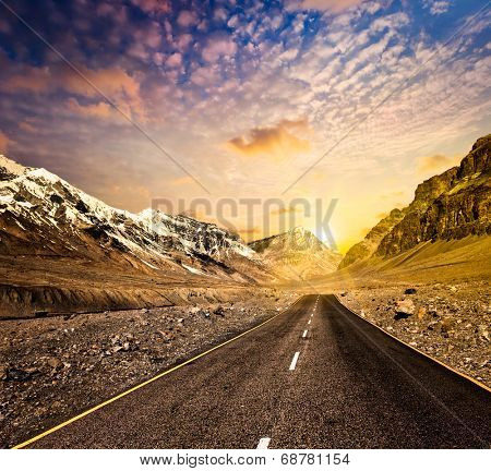 Road in Himalayas mountains on sunset