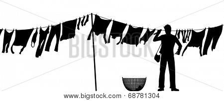 Editable vector silhouette of a man hanging clothes on a washing line