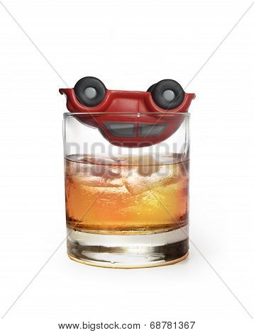 Toy Car On Glass Of Whiskey As Traffic Accident Due To Alcohol