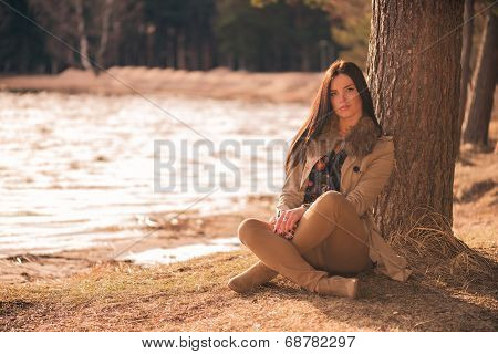 Brunette girl sitting cross-legged