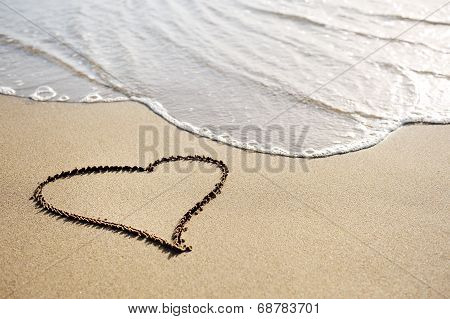 Love Concept - One Heart Drawn On The Beach Sand