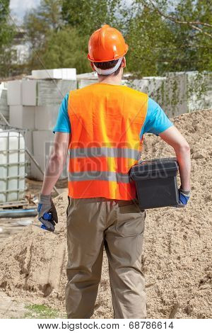 Blue-collar Worker With Toolbox And Grout Float
