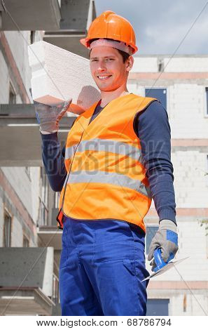Bricklayer Holding A Brick