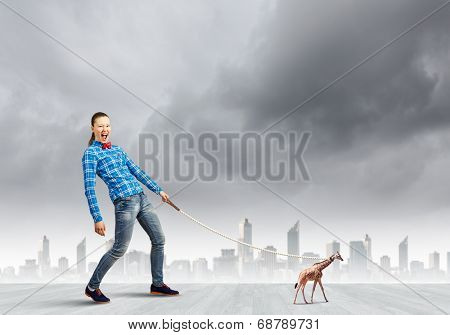 Young woman in casual and giraffe flying in sky