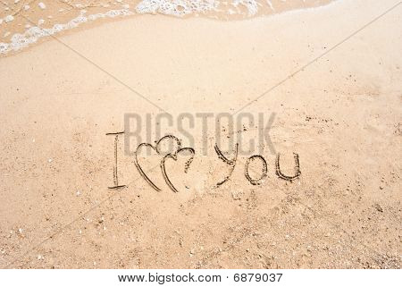 Inscription On Sand I Love You And Two Connected Hearts