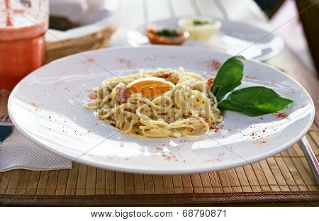 Delicious Italian pasta carbonara on a white plate