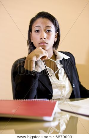 Close-up of young African-American woman studying with books on table