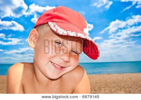 Portrait Of The Nice Child On Seacoast