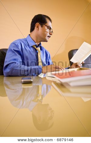 Middle-aged Hispanic businessman working in office