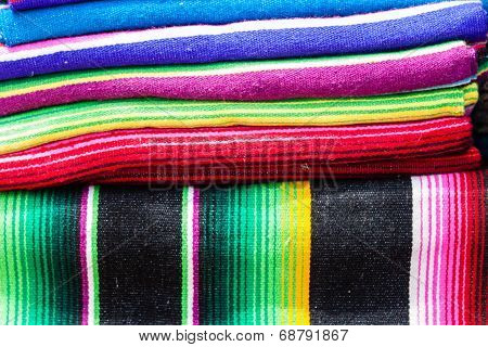 A stack of colored blankets